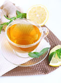 Cup of tea with ginger on napkin — Stock Photo