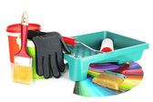 Plastic bucket with paint, roller, brushes and bright palette of colors — Stock Photo