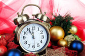 Alarm clock with Christmas decorations on table — Foto de Stock