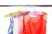 Beautiful dresses hanging on hangers — Stock Photo