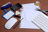 Office table with stationery accessories, keyboard and paper — Stock Photo