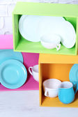 Beautiful  bright shelves and boxes with tableware — Stock Photo