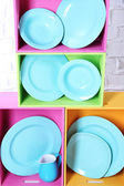 Beautiful  bright shelves and boxes with tableware — Photo