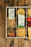 Italian products in wooden box on table — Stock Photo