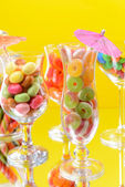 Different colorful fruit candy in glasses — Stock Photo