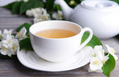 Cup of tea with jasmine — Stock Photo