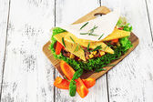Veggie wrap filled with cheese and fresh vegetables — Stock Photo