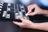 Black cinema clapper board in hands — Stok fotoğraf