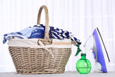 Colorful clothes in basket on table — Stock Photo
