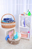 Colorful towels and clothes in baskets on table — Stok fotoğraf