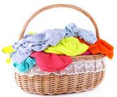 Bright clothes in laundry basket — Stock Photo