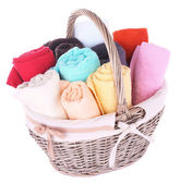Colorful towels in basket — Stock Photo