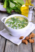 Delicious green soup with sorrel on table — Stock Photo