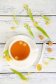 Tasty herbal tea with linden flowers — Stock Photo