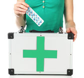 Woman holding first aid kit — Stockfoto