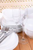 Set of white dishes on table — Stok fotoğraf