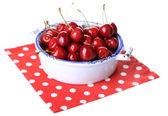Sweet cherry on color plate isolated on white — Stock Photo