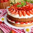 Delicious biscuit cake with strawberries — Stock Photo #48739827