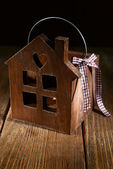 Small wooden house on wooden table — Stock Photo