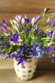 Beautiful wild flowers on table — Stock Photo