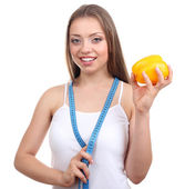 Beautiful girl with pepper and measuring tape — Stock Photo