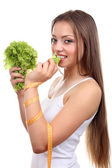 Beautiful girl with lettuce and measuring tape — Foto Stock