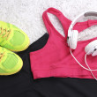 Sport clothes, shoes and headphones on white carpet background. — Stock Photo #48740629