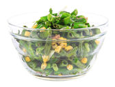 Salad with green beans, ham and  corn in glass bowl, isolated on white — Stock Photo