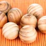 Wooden balls on bamboo mat — Stock Photo #48897627