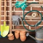 Tools of gardener on  bricks background — Stock Photo #48899991