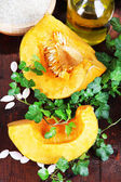 Cut pumpkin on wooden table close-up — Stock Photo
