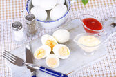Boiled eggs on wooden board — Stockfoto