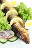 Smoked fish on plate close up — Stockfoto
