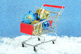 Christmas gifts in shopping trolley — Stock Photo