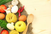 Groceries on wooden table — Stockfoto