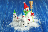 Beautiful snowmen and Christmas decor, on bright background — Foto de Stock