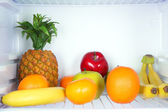 Fruits in open refrigerator. Weight loss diet concept. — Stok fotoğraf