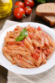 Pasta with tomato sauce on plate — Stock Photo
