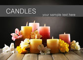Beautiful candles with flowers — Stock Photo