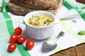 Tasty soup in saucepan — Stock Photo