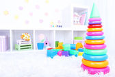 Colorful plastic toys in children room — 图库照片