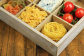 Italian products in wooden box — Stock Photo