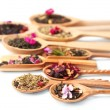 Assortment of dry tea in wooden spoons,  isolated on white — Stock Photo #48900359
