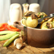 Young boiled potatoes in pan with vegetables on table in kitchen — Stock Photo #48901323