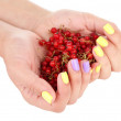 Female hands with stylish colorful nails holding ripe berries — Stock Photo #48903517