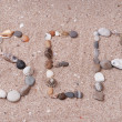 Word sea made from sea shells and stones on sand — Stock Photo #48906377