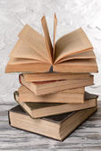 Old books on table on grey background — Foto Stock