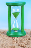 Hourglass in sand — Stock Photo