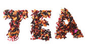 Tea mix with fruits and spices in a word shape — Stock Photo