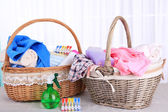 Colorful towels in baskets on table — Stock Photo